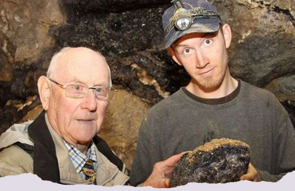 Peter Harrison and John Turner, pictured in 2013 with a piece from the newly-discovered Lost Vein.