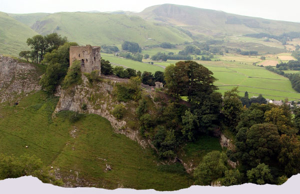 View of Peveril Castle with Treak Cliff Cavern in the background